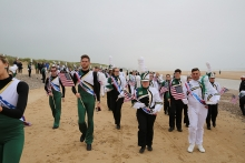 Pride of Niner Nation Marching Band at Omaha Beach in Normandy, France.