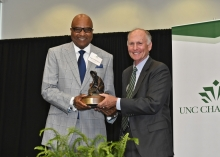 Fred Whitfield receives the 2019 Distinguished Service Award from Chancellor Dubois.