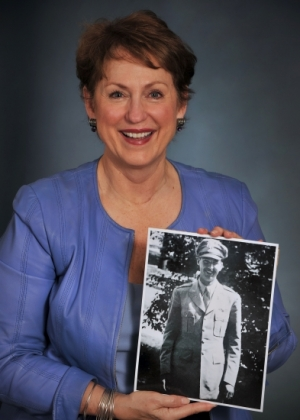 Jeanette Sims holds photo of her father, J. Brya Sims Jr.